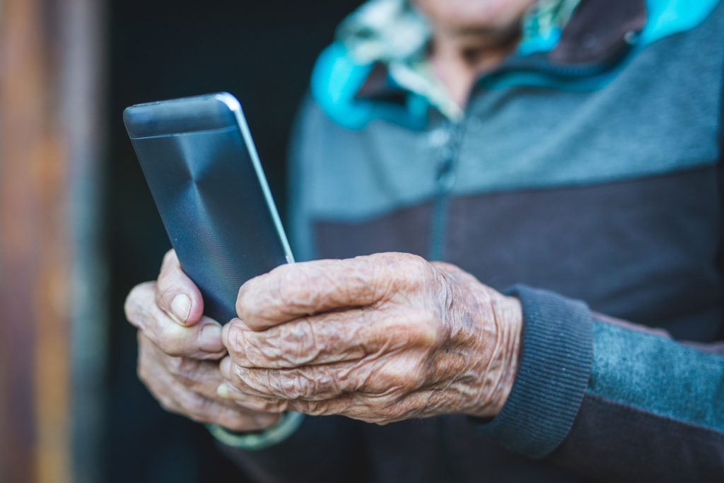 cropped-photo-of-elderly-man-using-smartphone