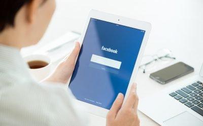 woman-looking-at-facebook-login-screen-on-tablet